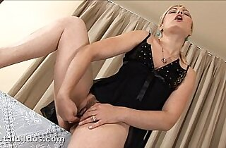 Blonde Ionella Inserting A Thick Dildo
