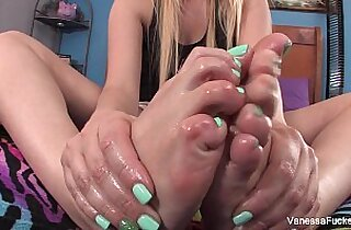 Vanessa Cage plays with her feet