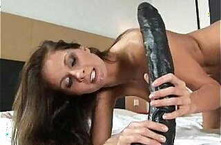 Gorgeous busty brunette Lauryn filling her pussy and asshole with dildos